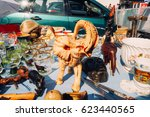 Small photo of FRANKFURT, GERMANY - AUGUST 23, 2015 : Closeup of a yellow ceramic elephant decoration and other objects for sale in a haggle in Frankfurt.
