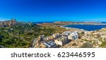 Small photo of Il-Mellieha, Malta - Beautiful panoramic skyline view of Mellieha beach and Mellieha town on bright summer day with Paris Church, Agatha Red Tower and island of Gozo at background with clear blue sky