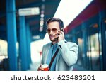 young businessman on rail... | Shutterstock . vector #623483201