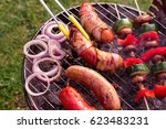 hand cooking at grill with... | Shutterstock . vector #623483231