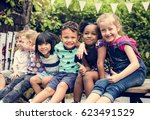 group of diverse kids sitting... | Shutterstock . vector #623491529