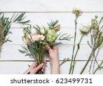 florist's hands making bouquet... | Shutterstock . vector #623499731
