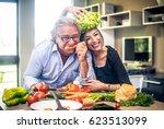 senior couple having fun in... | Shutterstock . vector #623513099
