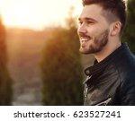 young handsome man in... | Shutterstock . vector #623527241