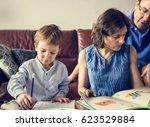 mom teaching her son doing...   Shutterstock . vector #623529884