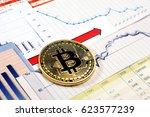a golden bitcoin on graph and... | Shutterstock . vector #623577239