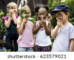 group of children are in a... | Shutterstock . vector #623579021