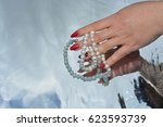 pearls and hands reflected in... | Shutterstock . vector #623593739