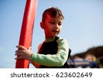 young boy with surf | Shutterstock . vector #623602649