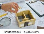 architect working on blueprint. ... | Shutterstock . vector #623603891