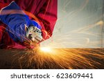 worker cutting metal with... | Shutterstock . vector #623609441