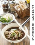 Small photo of  Fine Cut White Rice Noodle Thicken Soup with pork ball and beef.