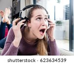 unhappy candid beautiful girl... | Shutterstock . vector #623634539