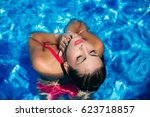 a young girl is swimming in the ... | Shutterstock . vector #623718857