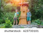 Two Boys Next To Small Mill In...