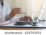 male doctor on video conference ... | Shutterstock . vector #623741921