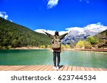back of girl travel alone stand ... | Shutterstock . vector #623744534