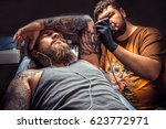 master doing tattoo in tattoo... | Shutterstock . vector #623772971