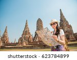 asian tourist woman with map... | Shutterstock . vector #623784899
