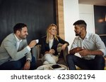 colleagues making a coffee... | Shutterstock . vector #623802194