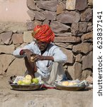 an old bespectacled indian...