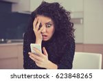 young shocked anxious woman... | Shutterstock . vector #623848265