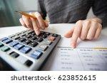 closeup of accountant hands... | Shutterstock . vector #623852615