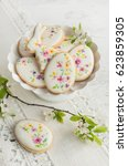 colorful easter biscuits.... | Shutterstock . vector #623859305