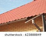 repairing damaged gutters.... | Shutterstock . vector #623888849