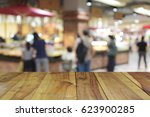 blurred image wood table and... | Shutterstock . vector #623900285