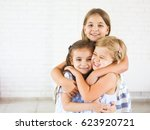 happy funny girls embrace... | Shutterstock . vector #623920721