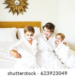 happy mother and daughters... | Shutterstock . vector #623923049