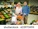 family couple buying  fruits in ... | Shutterstock . vector #623973494