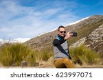 man photographed mountains in... | Shutterstock . vector #623997071