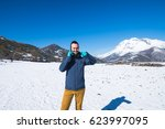 man photographed mountains in... | Shutterstock . vector #623997095