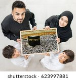 family with a frame of kaaba in ... | Shutterstock . vector #623997881