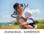 beautiful young mother with her ... | Shutterstock . vector #624004424