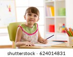 smiling kid girl drawing with... | Shutterstock . vector #624014831