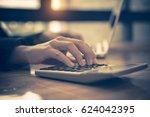 businessgirl working on desk... | Shutterstock . vector #624042395