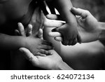 black children's hands hold... | Shutterstock . vector #624072134