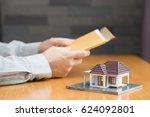 businessman holding home loan... | Shutterstock . vector #624092801