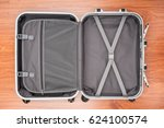 opened empty travel bag on... | Shutterstock . vector #624100574