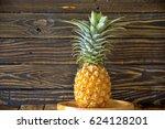 pineapple on wooden background | Shutterstock . vector #624128201