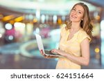 woman with laptop  | Shutterstock . vector #624151664