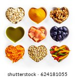 Small photo of Concept of healthy food for the heart and cardiovascular system with heart-shaped dishes containing oats, turmeric, walnuts, salmon, acai, carrot, lentils, bell peppers and olive oil isolated on white
