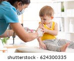 doctor pediatrician give... | Shutterstock . vector #624300335