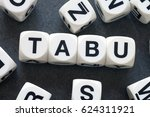 Small photo of word tabu on white toy cubes