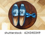 blue shoes and bow tie on a... | Shutterstock . vector #624340349
