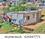 Small photo of Solar panels on the roof of shack at Informal settlement - Enkanini, on the outskirts of Stellenbosch, Western Cape, South Africa. Many shacks in Enkanini have solar panels for access to electricity.