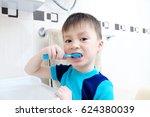 child portrait brushing teeth ... | Shutterstock . vector #624380039